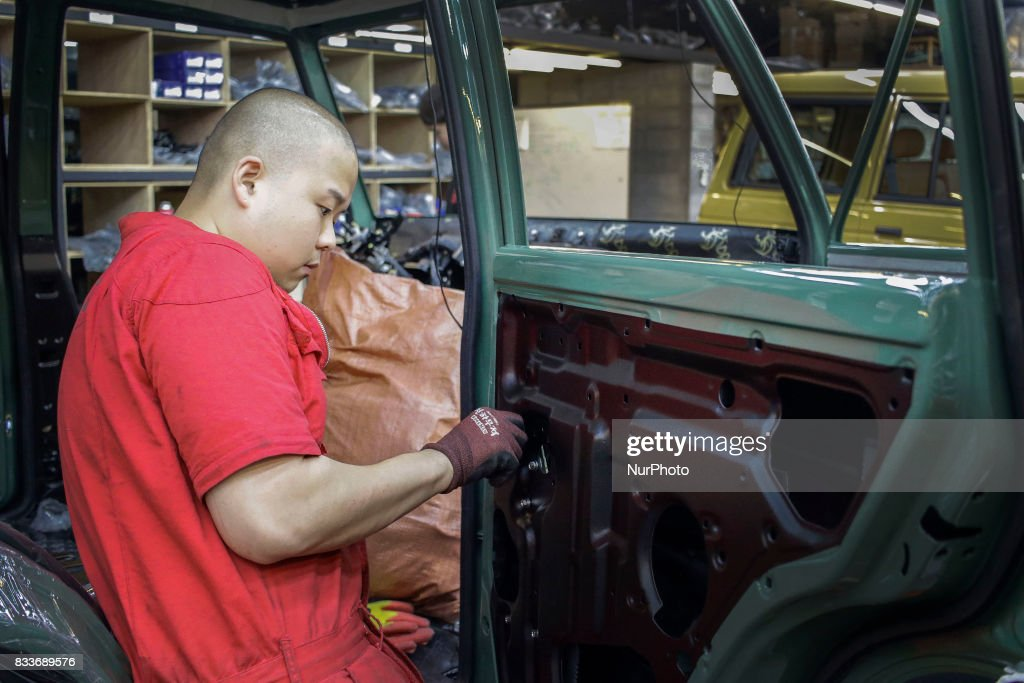 """Worker take confirm to coating side at mohenic garages in Paju, South Korea. A 20-year-old beat up Hyundai SUV isn't anyone's idea of a dream car. But used Hyundai Gallopers, priced between $2,000 to $3,000 at second-hand car markets, are making a comeback , reborn as upwards $80,000 luxury vehicles at the hand of former furniture designer Henie Kim. Kim is now the CEO of Mohenic Garages, a car rebuilding company based in Paju has transformed the boxy classic into one of South Korea's most highly-desired cars. """"As a former designer, I wanted make everything perfect."""" The remade """"Mohenic G"""", as they're known, take their design cues from the 1990s and come in a variety of custom colors from """"mint racing green"""" to """"midnight cerulean blue"""". Demand for the """"Mohenic G"""" has steadily risen, and the waitlist is long. Since 2013, only 43 cars have been rebuilt and 48 customers are on a waiting list. Production is slow though since the company expanded, they're able to produce 30 cars a year, or about 2 cars a month. A team of two dozen workers transform each car in a meticulous process that includes prying the car cabin from its frame, sanding, removing corrosive substances, polishing and painting."""