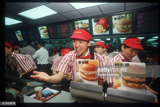 Worker Takes An Order From A Customer In China's First Mcdonald's Restaurant April 23 1992 In Beijing China Mcdonald's Opened Its World's Largest...