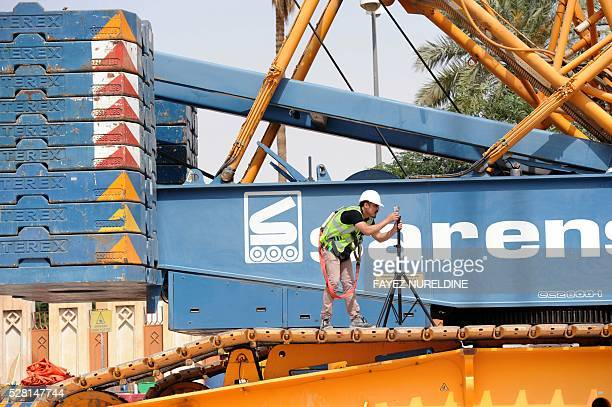 A worker takes measurement on May 4 2016 at a construction site of a section of the Saudi capital Riyadh's $225 billion metro system The system which...