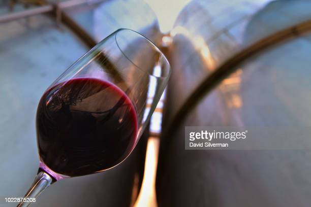 A worker takes samples of Cabernet Sauvignon wine from large stainless steel fermentation tanks at the height of the wine harvest at Carmel Winery...