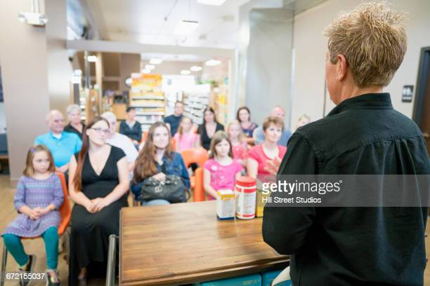 worker teaching class in nutrition store - commercial event stock photos and pictures