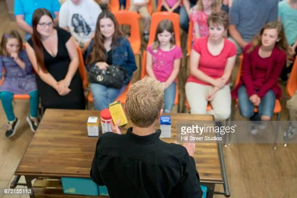 Worker teaching class in nutrition store