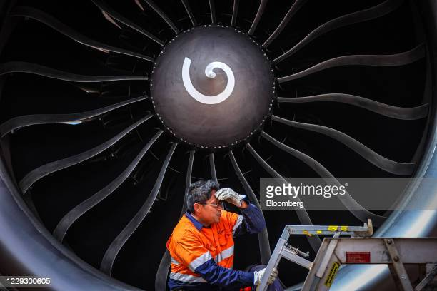 Worker tends to the engine of an aircraft during the induction process at the Asia Pacific Aircraft Storage Facility in Alice Springs, Northern...