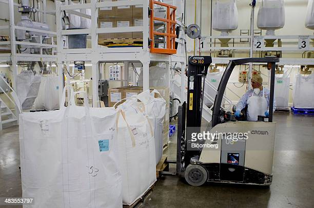 A worker transports bags of gluten free flour at the Bob's Red Mill and Natural Foods facility in Milwaukie Oregon US on Tuesday April 8 2014 Bob's...