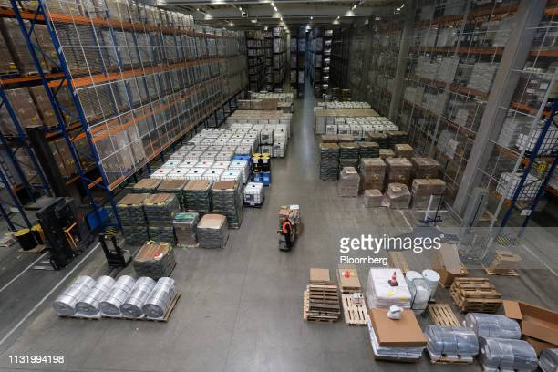 A worker transports goods through the NeeleVat Logistics BV distribution warehouse during a 'Get Ready For Brexit' press tour of the Port of...