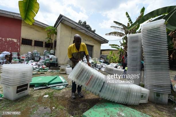 A worker tries to carry empty ballot boxes at the Independent National Electoral Commission office in Port Harcourt Rivers State on March 8 2019...