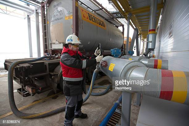 A worker turns a valve to load motor oil additives onto a tanker at the Royal Dutch Shell Plc lubricants blending plant in Torzhok Russia on Tuesday...