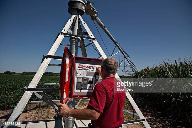 A worker turns on a Lindsay Corp Zimmatic center pivot irrigation system during a demonstration in a field outside Omaha Nebraska US on Wednesday Aug...
