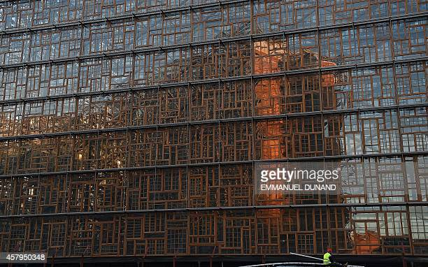 A worker unloads material i on October 27 2014 n front of the construction site of the new European Council headquarters in Brussels as the European...