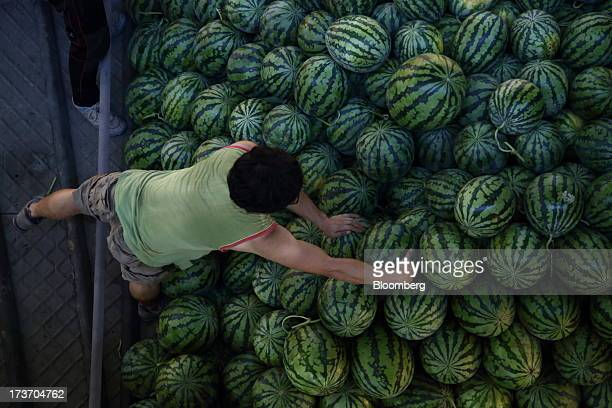 Worker unloads watermelons from a truck at Noeun Agricultural and Marine Products Wholesale Market in Daejeon, South Korea, on Tuesday, July 16,...