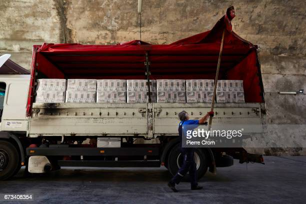 A worker unloads wine in a wine cellar a former military base in the stateowned winery Plantaze on April 26 2017 in Podgorica Montenegro Russia has...