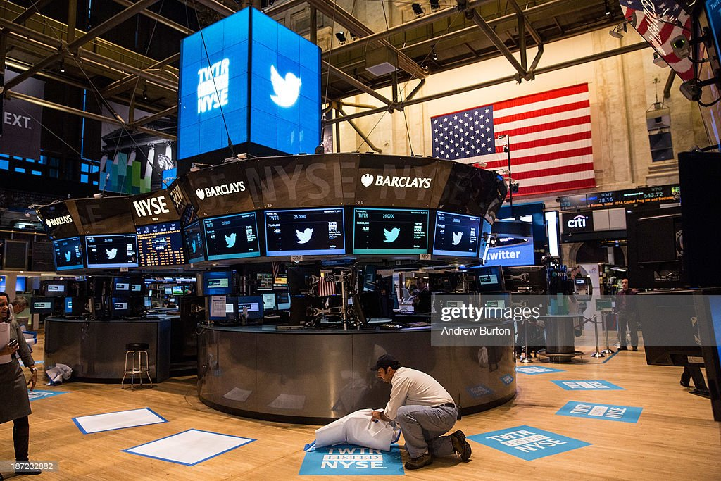 A worker unveils a floor mat bearing the logo of Twitter and the symbol on which Twitter's stock will traded (TWTR) on the floor of the New York Stock Exchange (NYSE) on November 7, 2013 in New York City. Twitter goes public on the NYSE today, it is expected to open at $26 per share, making the company worth an estimated $18 billion.