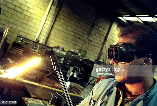 A worker uses a blowtorch in a workshop 8 June 2000 AFR Picture by ROB HOMER