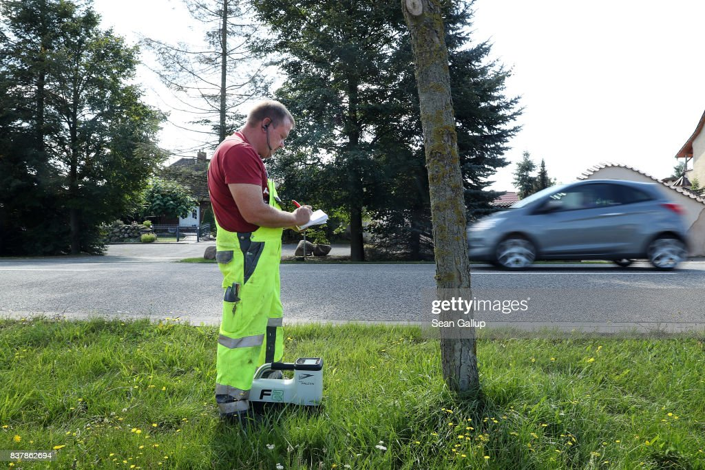 A worker uses a device to monitor the progress of a drill digging a horizontal hole in the ground below him during the installation of broadband fiber optic cables in the village of Bebertal by a private company called MDDSL on August 23, 2017 near Haldensleben, Germany. The German government is subsidizing efforts to improve broadband access in rural areas. Germany faces elections on September 24 and rural development is a strongly political issue. Many rural areas in Germany, especially in the eastern parts, are facing challenges, especially due to demographics.