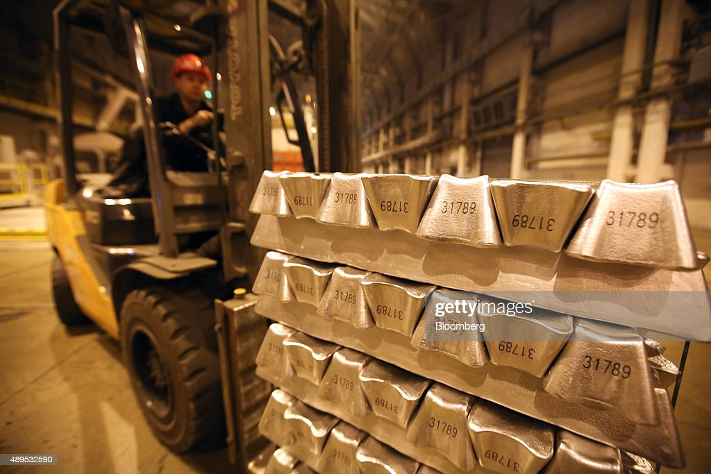 A worker uses a fork-lift truck to move palettes of aluminum ingots in the foundry at the Irkutsk aluminium smelting plant, operated by United Co. Rusal, in Shelekhov, Russia, on Monday, Sept. 21, 2015. The biggest aluminum producers are discussing the introduction of a 'green' trademark for the lightweight metal that could be sold at a premium and encourage carbon footprint reductions among rivals, United Co. Rusal's deputy chief executive officer said. Photographer: Andrey Rudakov/Bloomberg via Getty Images