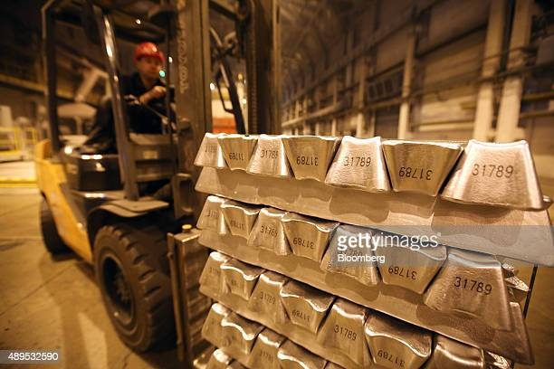 A worker uses a forklift truck to move palettes of aluminum ingots in the foundry at the Irkutsk aluminium smelting plant operated by United Co Rusal...