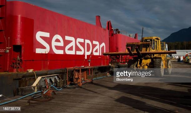 A worker uses a forklift while repairing a dock at the Seaspan Vancouver Shipyard in North Vancouver British Columbia Canada on Wednesday Oct 9 2013...