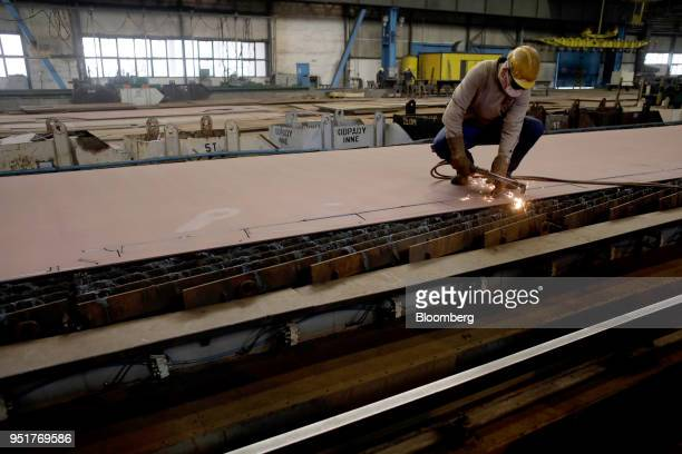 Worker uses a gas torch to weld steel ship sections at the GSG Towers Sp. Z o.o. Factory, a unit of the Gdansk Shipyard Group, in Gdansk, Poland, on...