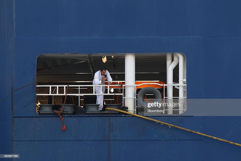 A worker uses a handheld transceiver inside a Nippon Yusen Kaisha (NYK Line) roll-on/roll-off (RORO) vehicle cargo ship at the port of Pyeongtaek in Pyeongtaek, South Korea, on Monday, Sept. 30, 2013. South Koreas consumer confidence sank to a five-month low in September, even after a rebound in exports fueled the fastest economic growth in two years last quarter. Photographer: SeongJoon Cho/Bloomberg via Getty Images