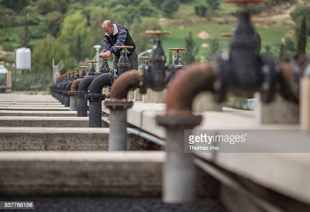 A worker uses a handwheel on a sludge drying bed in a sewage treatment plant on April 06 2016 in Fuheis Jordan