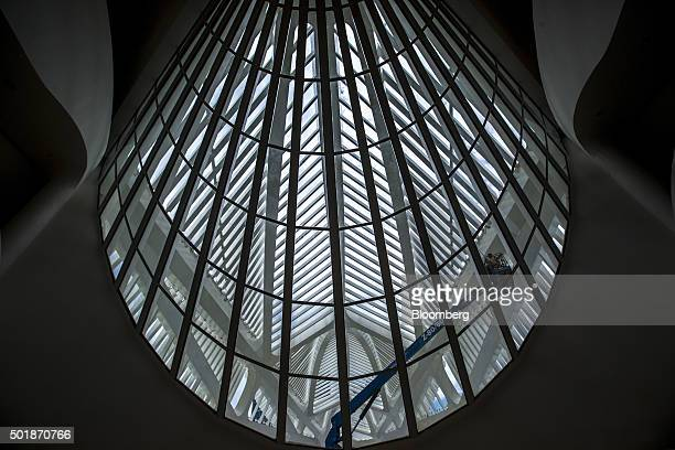 A worker uses a hydraulic lift during the final phase of construction at the Museum of Tomorrow in Rio de Janeiro Brazil on Monday Dec 14 2015 The...