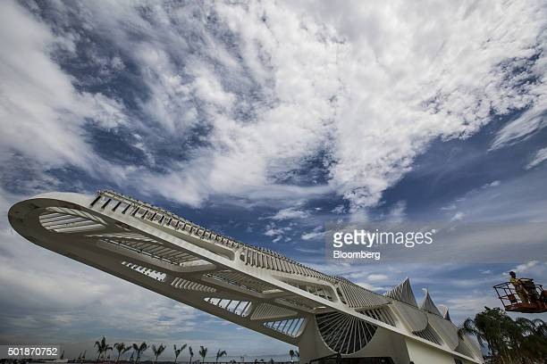 A worker uses a hydraulic lift right during the final phase of construction at the Museum of Tomorrow in Rio de Janeiro Brazil on Monday Dec 14 2015...