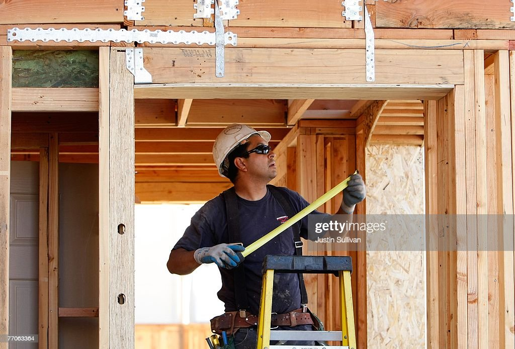 A worker uses a measuring tape while building a new home at a housing development September 27, 2007 in Richmond, California.Tthe Commerce Department reported today that sales of new homes fell 8.3 percent in August, bringing sales to an annual rate of 795,000 units, the lowest level since June 2007.