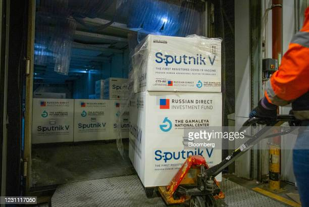 Worker uses a pallet trolley to remove boxes of the Sputnik V COVID-19 vaccine, developed by the Gamaleya National Research Center for Epidemiology...