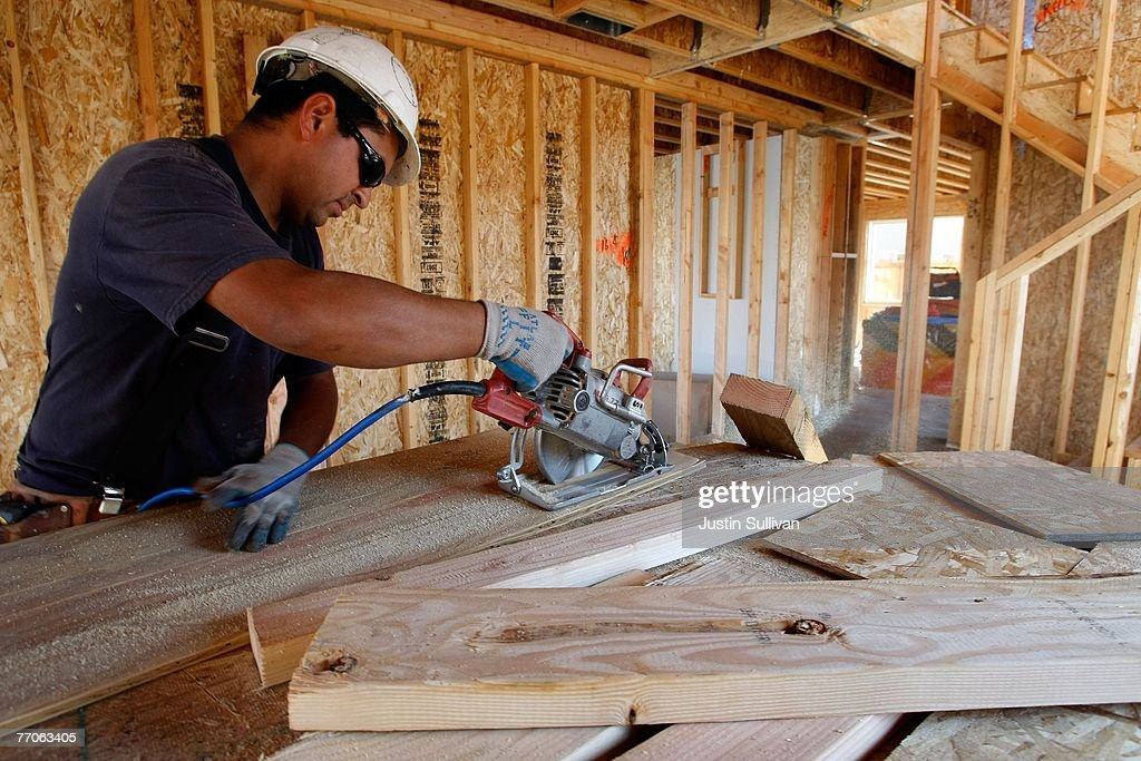 A worker uses a saw while building a new home at a housing development September 27, 2007 in Richmond, California.Tthe Commerce Department reported today that sales of new homes fell 8.3 percent in August, bringing sales to an annual rate of 795,000 units, the lowest level since June 2007.
