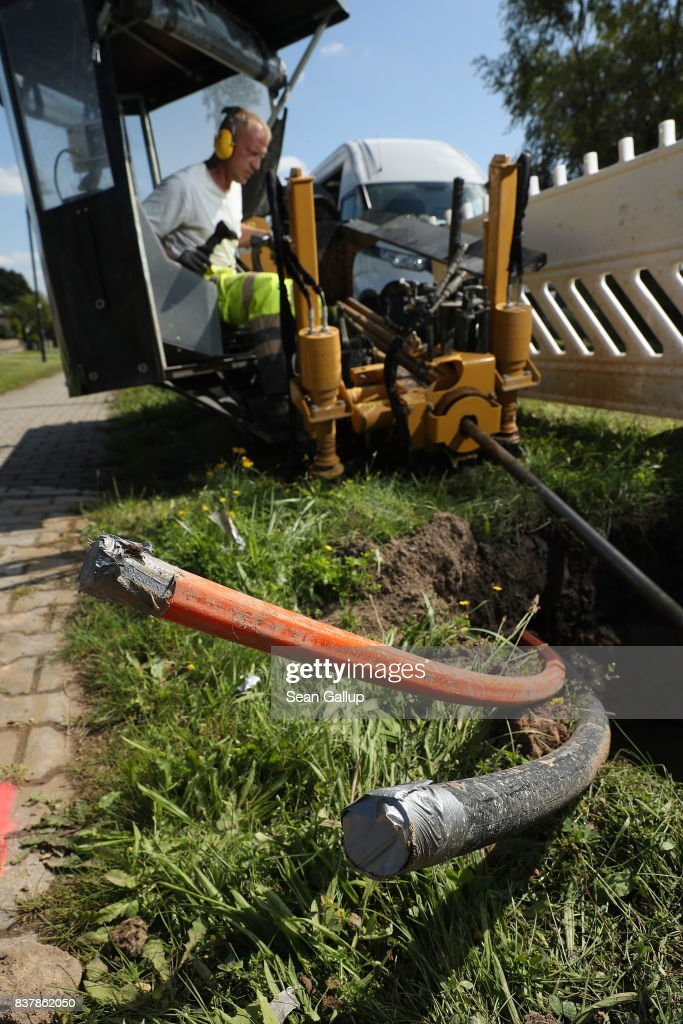 A worker uses a specialized drilling vehicle for digging a horizontal hole to accomodate tubing used for laying fiber optic cable underground during the installation of broadband infrastructure in the village of Bebertal by a private company called MDDSL on August 23, 2017 near Haldensleben, Germany. The German government is subsidizing efforts to improve broadband access in rural areas. Germany faces elections on September 24 and rural development is a strongly political issue. Many rural areas in Germany, especially in the eastern parts, are facing challenges, especially due to demographics.