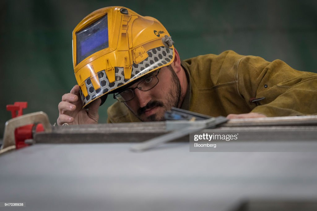A worker uses a square to measure the side of a door during production at the Metal Manufacturing Co. facility in Sacramento, California, U.S., on Thursday, April 12, 2018. The Federal Reserve is scheduled to release industrial production figures on April 17. Photographer: David Paul Morris/Bloomberg via Getty Images
