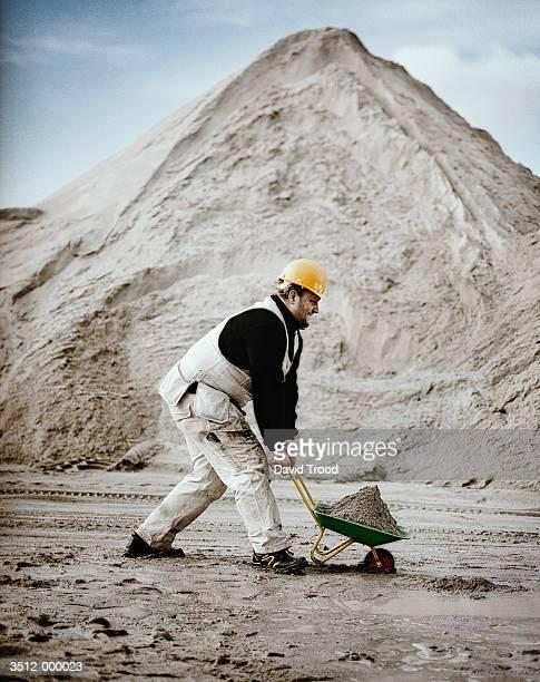 Worker uses Small Wheelbarrow