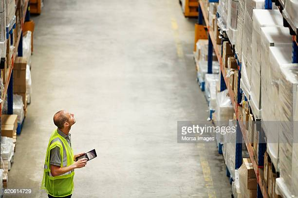 Worker using digital tablet at warehouse