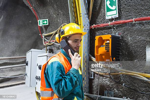Worker using emergency phone
