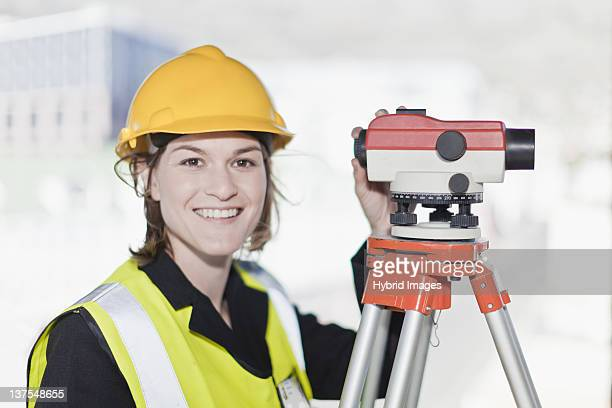 Worker using equipment on site