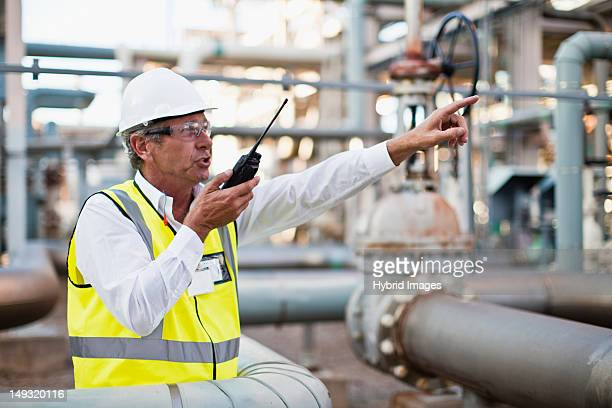 Worker using walkie talkie on site