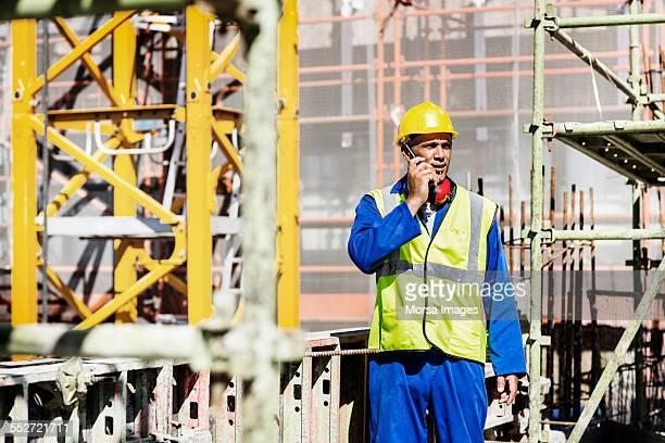 Worker using walkie-talkie at site