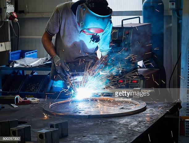 Worker using welder