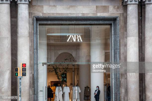 Worker waits for customers at the entrance to a Zara clothing store, operated by Inditex SA, in Barcelona, Spain, on Monday, March 8, 2021. Inditex...