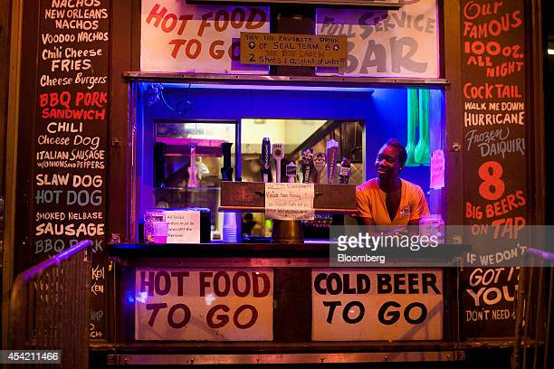 A worker waits for customers in the window of a togo restaurant and bar on Beale Street at dusk in downtown Memphis Tennessee US on Saturday Aug 16...