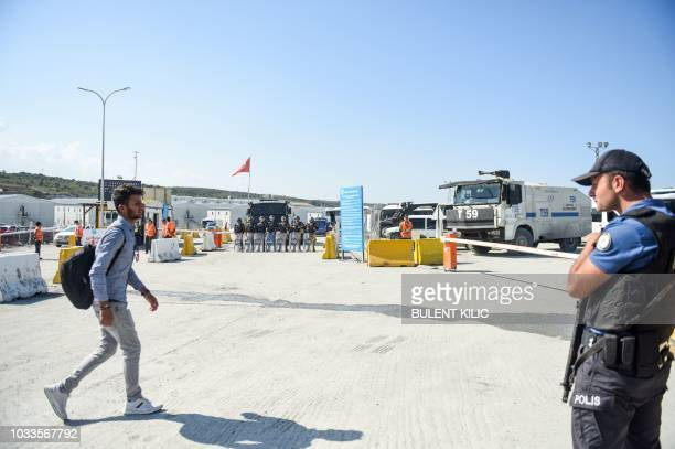 Worker waits near the police barricade at the entrance of Istanbul new airport building site on September 15 in Istanbul. - Turkish police have...