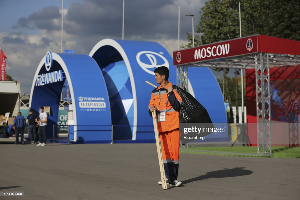 A worker waits near the promotional pavilion for the Dalian Wanda Group Co. during preparations ahead of the FIFA World Cup outside the Luzhniki stadium in Moscow, Russia, on Wednesday, June 13, 2018. According to an April report from the organizing committee, the total amount spent on preparations is 683 billion rubles, or about $11 billion at the current exchange rate. Photographer: Andrey Rudakov/Bloomberg via Getty Images