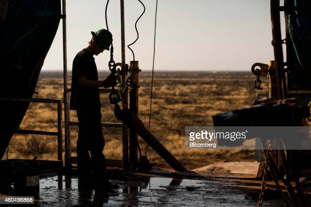 A worker waits to connect a drill bit on Endeavor Energy Resources LP's Big Dog Drilling Rig 22 in the Permian basin outside of Midland Texas US on...