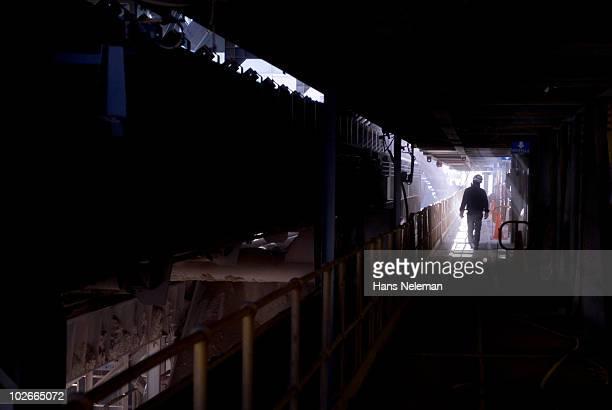Worker walking in a mining company