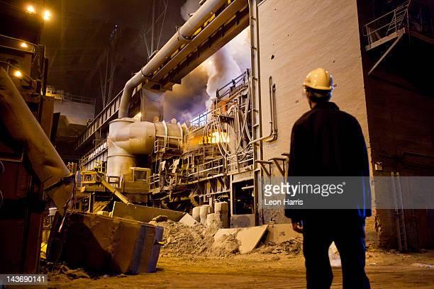 Worker walking in steel forge