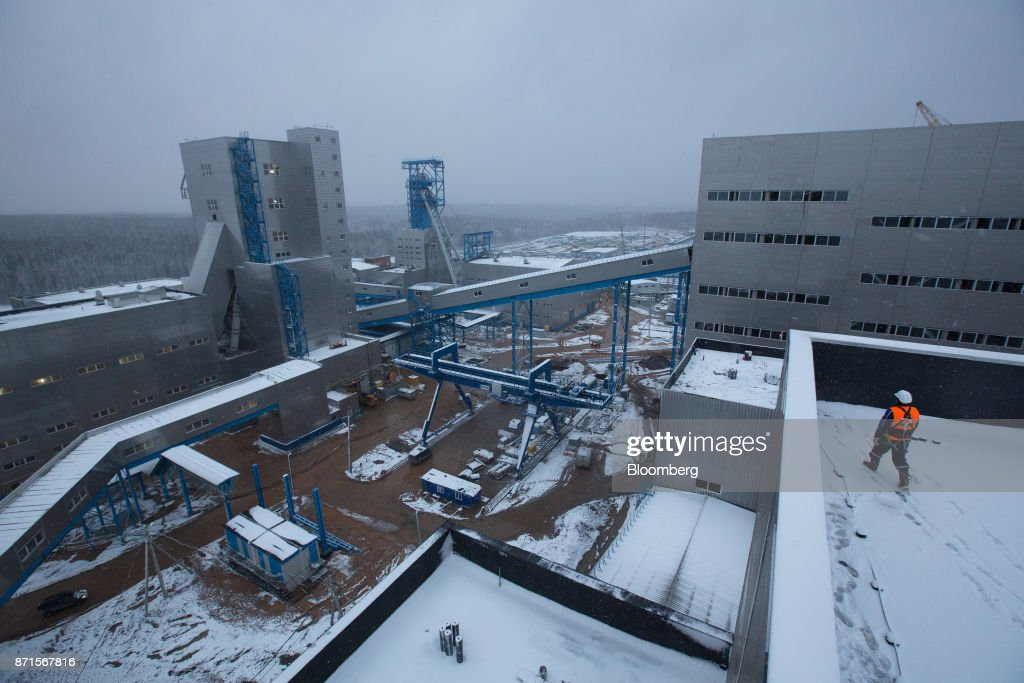 A worker walks across a plant building at the Usolskiy