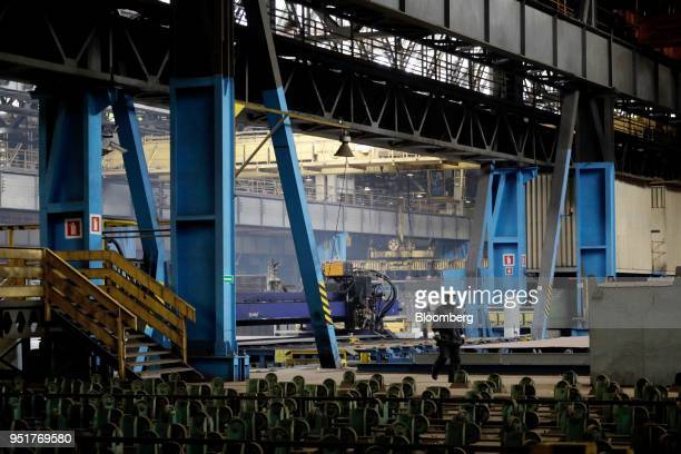 Worker walks across the factory floor at the GSG Towers Sp. Z o.o. Factory, a unit of the Gdansk Shipyard Group, in Gdansk, Poland, on Wednesday,...