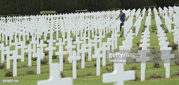 A worker walks among the thousands of crosses marking the graves of French soldiers killed in the Battle of Verdun at the ossuary of Douaumont on May...