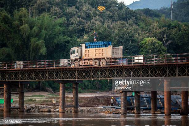 A worker walks atop a lorry on the construction site of the Ban Ladhan Railway bridge a section of the ChinaLaos Railway built by the China Railway...