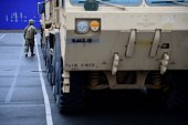bremerhaven germany worker walks military vehicles
